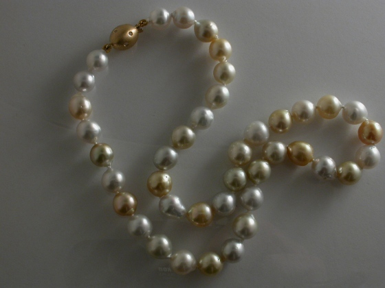 67228 - White & Golden Naturally coloured South Sea Pearls with 18ct & Diamond Ball safety clasp