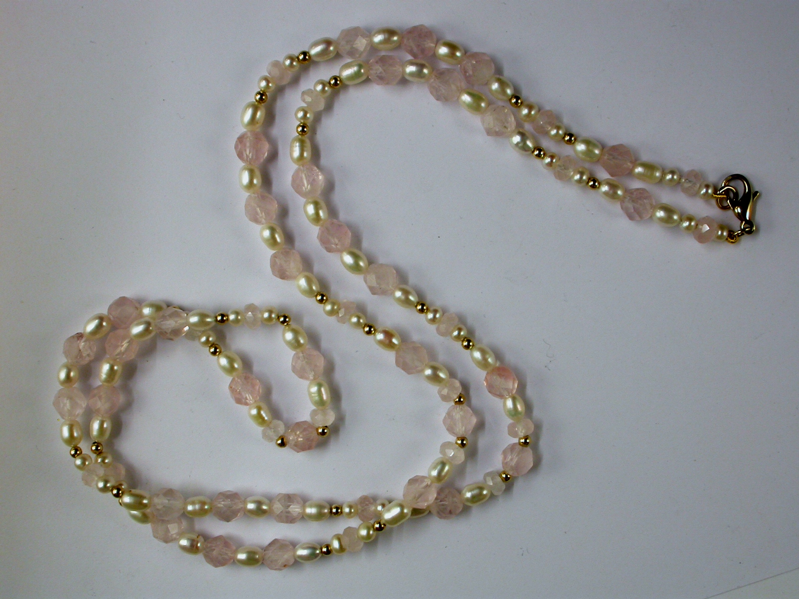 68029 - Rose Quartz & Cultured Pearl strung in an Opera length necklace with gold highlights
