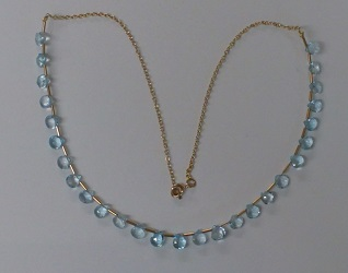 68252 - Blue Topaz fringe necklace in 9ct yellow gold