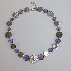 68537 - Handmade sterling silver necklace featuring hammered decoration & Amethyst beads
