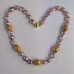 68566 - Pink/Purple Semi Baroque Pearls with Vermeil highlights