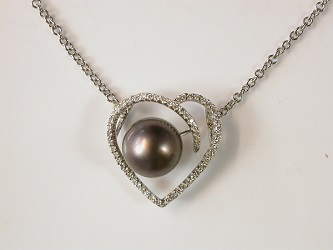 69972 - Tahitian Pearl set in Heart shaped pave Diamond border set in 18ct white gold including chain